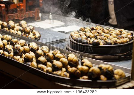 Turkish roasted chestnuts street shop evening background .