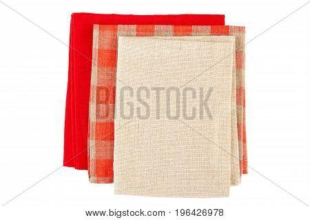 Thrww folded colorful napkins isolated on white background