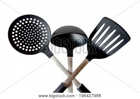 Kitchen tool of the three items a ladle etc.