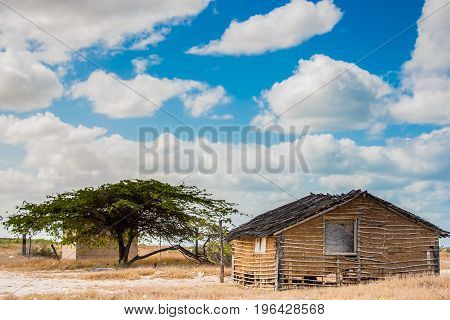 Traditional adobe house on the desert under blue sky