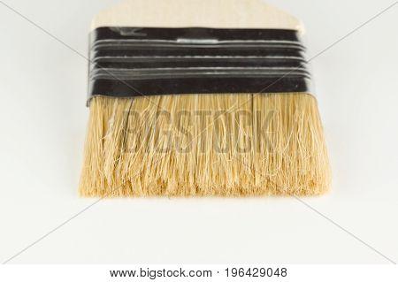 Large flat paint brush on white background