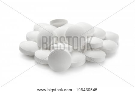 Health care concept. Round pills on white background