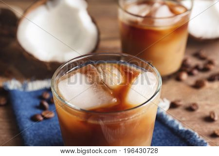 Glass of cold tasty coconut coffee, closeup