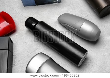 Various deodorants for men on light background