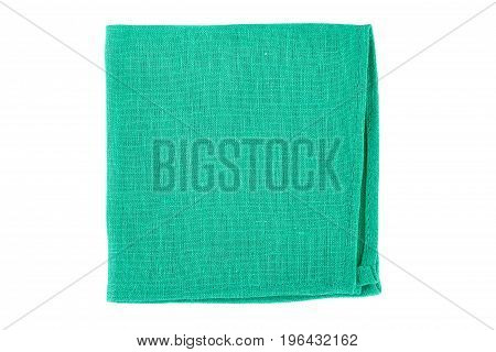 Green textile napkin isolated on white background