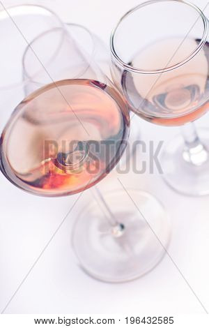 closeup of rose wine glasses of different shapes and sizes with selective focus