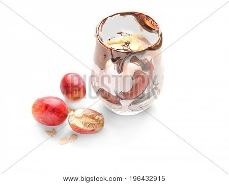 Delicious yogurt parfait with chocolate sauce in glass and grapes on white background