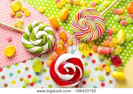 Tasty candies on colorful background