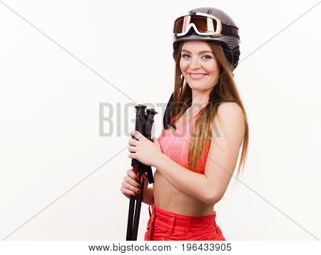 Woman Wearing Ski Suit And Helmet Holding Poles