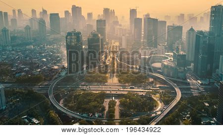 JAKARTA Indonesia. May 12 2017: Aerial view of circular flyover in modern city at sunset time