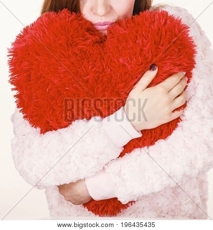 Angry Woman Holding Heart Shaped Pillow