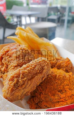 lunch set of crispy deep fried chicken and french fries unhealthy eating