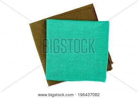 Two folded textile napkins isolated on white background