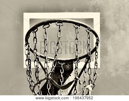 Playground. In the frame is a shield and a ring with chains. Harsh basketball. Ukraine the Kiev area. Black and white image