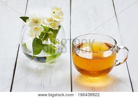 Jasmine Tea And Jasmine Flowers On A White Wooden Table