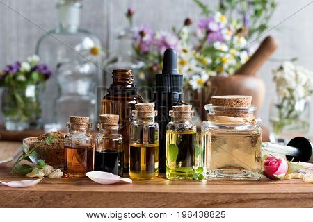Selection Of Essential Oils With Herbs And Flowers