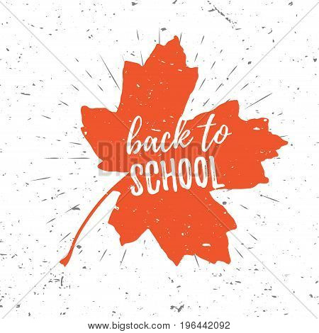 Back to school lettering typography on red maple leaf with burst on a old textured background. Hand drawn trendy design for a logo, greeting cards, invitations, posters, prints, banners, t-shirts.