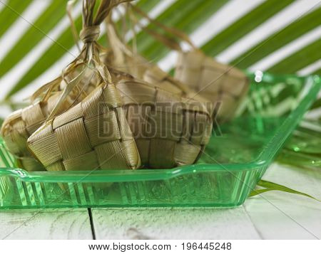 bunch of the kketupat on the green tray