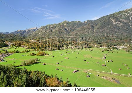 Alpine Aerial View Of Bavarian Valley With Green Pastureland
