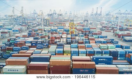 JAKARTA Indonesia. July 10 2017: Aerial view of many containers and cranes with container ship berthing at industrial port