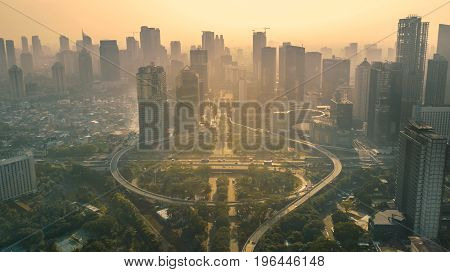 JAKARTA Indonesia. May 12 2017: Aerial view of the road junction and interchange overpass in downtown at sunset time