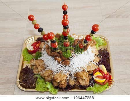 The close view of trimmed dish of fish and salad (Lithuania).