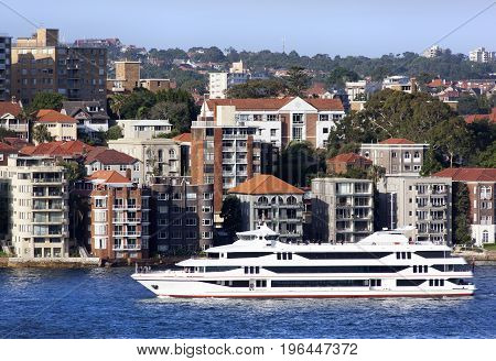 The ferryboat passing Kirribilli apartment buildings one of the most established residential districts in Sydney (New South Wales).