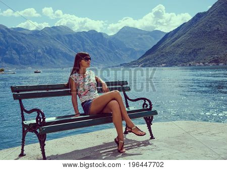 Beautiful Young Woman Looking And Waiting At The Seacoast. Sunny Day. Montenegro, Europe. Retro Styl