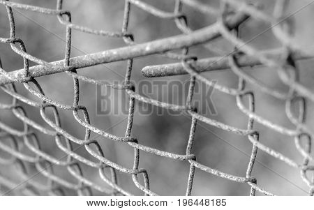 Post apocalyptic texture. Protection metallic steel mesh fence in prison