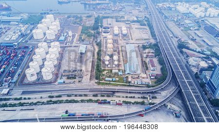 JAKARTA Indonesia. July 10 2017: Aerial view of containers and oil tanks in Tanjung Priok industrial port