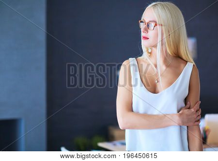 Portrait of an executive professional mature businesswoman sitting on office.