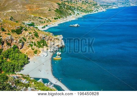 Preveli Beach in Crete island Greece. There is a palm forest and a river inside the gorge near this beach.