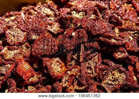 Closeup of Italian sun dried tomatoes. Mediterranean food background. Cefalu - Sicily Food Market