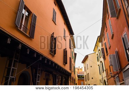 Narrow Street With Colourful Facades And Wooden Window Shutters
