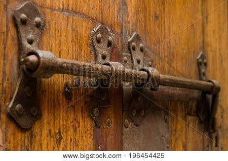 Massive Old Rusty Iron Lock On Wooden Door