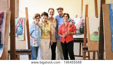 Group Portrait Of Elderly People Smiling At Art School