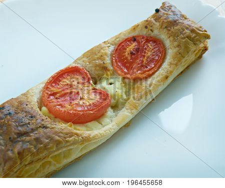 Pastry Tart With Cheese And Tomatoes