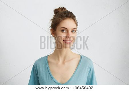 Pleasant-looking Woman With Blue Eyes, Thin Lips And Pure Skin Looking With Smile At Camera Rejoicin