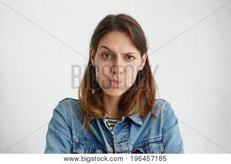 Headshot Of Displeased European Woman Blowing Her Cheeks Being Upset Raising Her Eyebrows, Demonstra