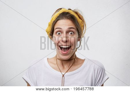 Excited Female Looking With Widely Opened Eyes And Jaw Dropped Having Happy And Surprised Expression