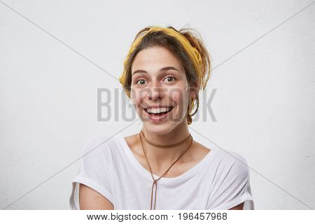 Horizontal Portrait Of Pretty Female Having Dark Eyes, Pure Skin Wearing Yellow Scarf On Head And Wh