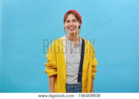 Cheerful Hipster Girl In Good Mood, Planning To Spend Weekends Outdoors In Forest Or By Water, Dress
