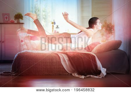 Sleep paralysis concept. Young woman levitating over bed