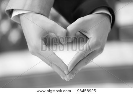 Gay couple making heart with hands and USA flag on background