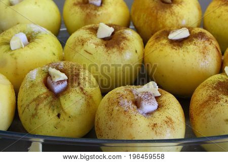 Cooking baked apple with cinnamon, butter and sugar