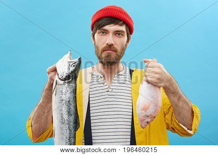 Picture Of Handsome Young Caucasian Angler Or Fisherman With Blue Eyes And Beard Holding Two Fish, L