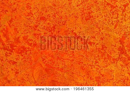Red and gold texture. Decorative plaster. Interior wall decoration. Textured background.