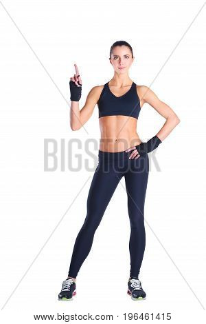 Muscular young woman posing in sportswear against white background