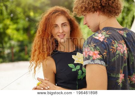 Portrait Of Lovely Red-haired Woman With Beautiful Appearance Spending Her Free Time With Boyfriend
