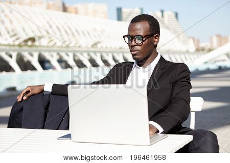 Elegant Dark-skinned Businessman With Seriuos Expression Having Full Lips And Pure Skin Wearing Eyew